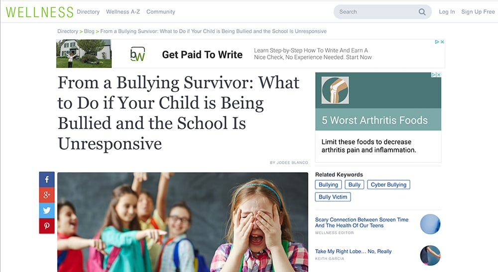 Article about bullying with image of a child crying while being bullied